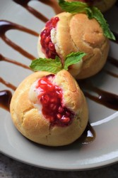 Mini Raspberry Profiteroles with Vanilla-Clove Custard