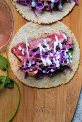 Steak Tacos with Cabbage Slaw, Lime Crema & Pickled Red Onions